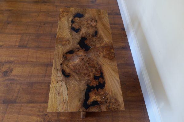 Top view of burr elm waterfall coffee table