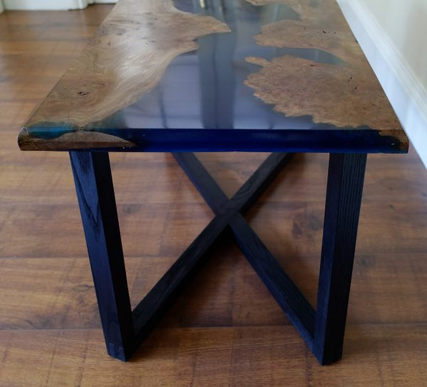 End view of burr elm and resin coffee table on ebonised ash legs