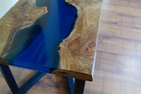 Elm and blue polished epoxy resin coffee table on ebonised ash legs