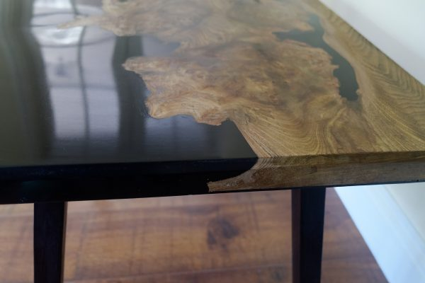 Burr elm and resin coffee table showing wood grain detail