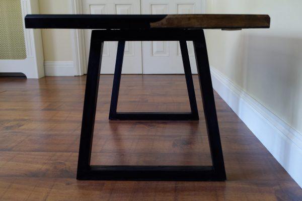Elm coffee table on ebonised ash legs