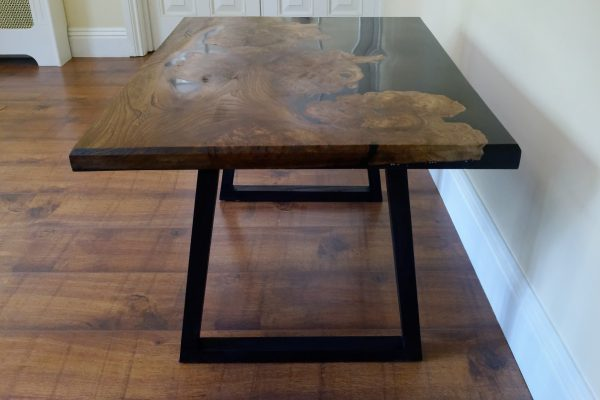 Burr elm and resin coffee table with ebonised ash legs