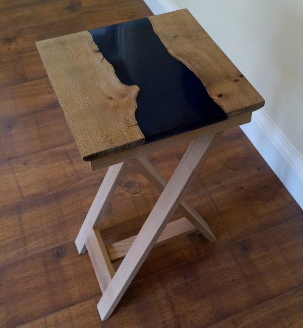 Lamp table on tripod legs with blue polished epoxy resin river