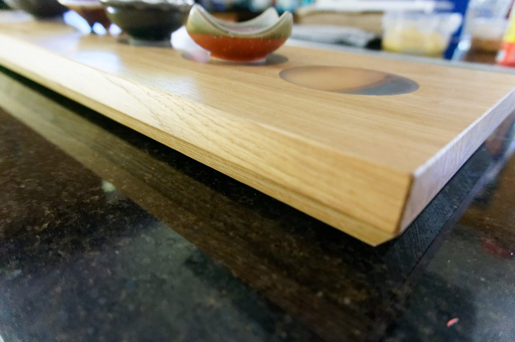 Close up of Oak Charcuterie Board showing 'log' inserts