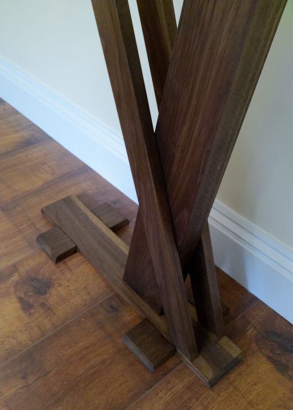 Walnut console table with crossover legs
