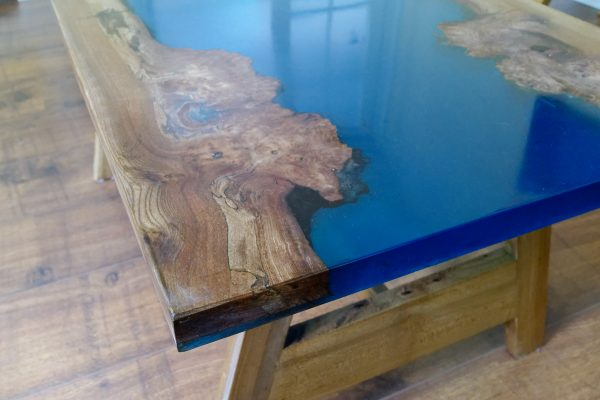Close up of burr Elm and Marine Blue Epoxy Resin Table top