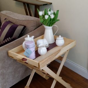 Ash and purple resin table with removable try dressed with tea cups and flowers