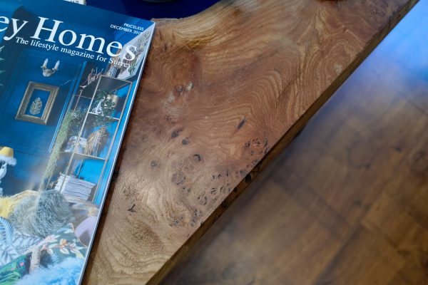 Burr Elm coffee table close up showing grain of wood and cats-paws