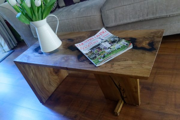 Burr Elm Coffee table dressed with Magazine and Vase of Flowers