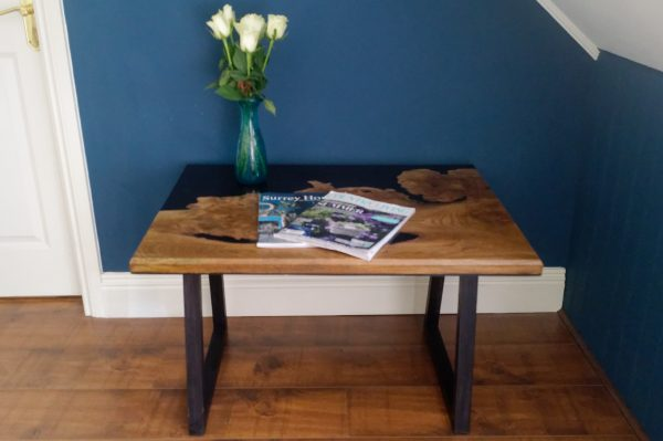 Burr Elm and Black Resin Table with Flower Vase and Magazines