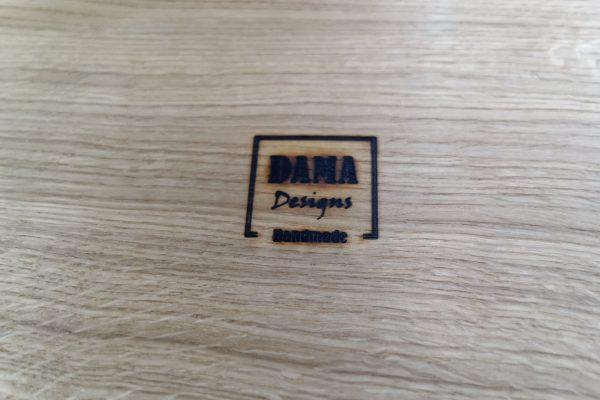 DAMA Designs Logo Burnt into Wood