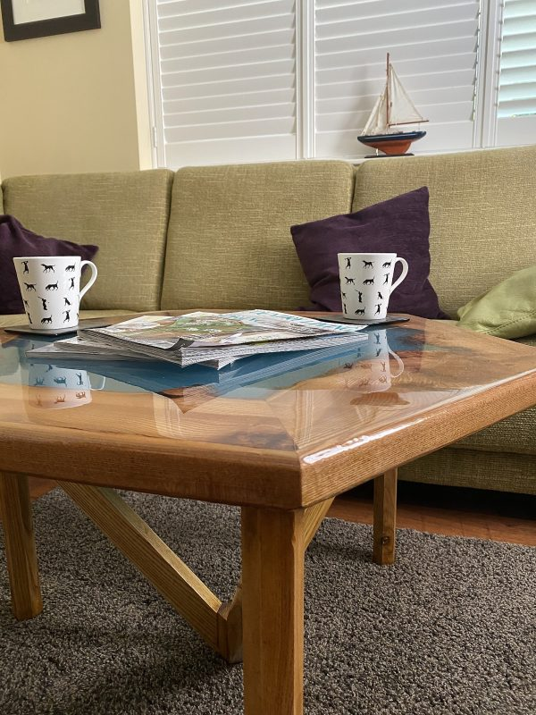 Burr Elm and Resin Coffee Table showing Flood Coated Gloss Finish