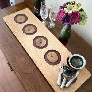 Oak and purple resin Charcuterie Board with flowers glasses and champagne bottle