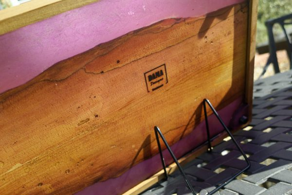 Underside of elm ottoman tray showing feet and branding