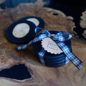 Black Resin Coasters with Log Insets on Coffee Table