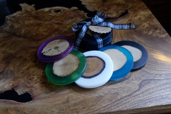 Multi-Coloured Round Coasters made from Resin and Hardwood on Coffee Table