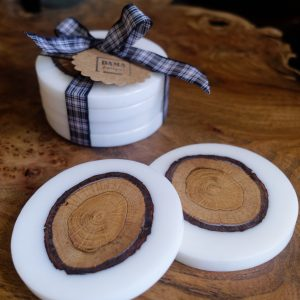 Set of White Coasters with Oak Insets on Table