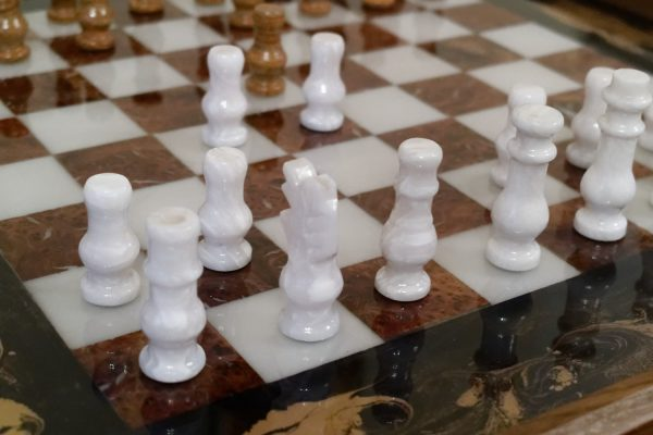 Close Up of Chess Board Ottoman Tray with Chess Pieces