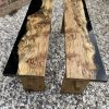 Two matching benches made from English oak and resin