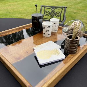 Elm and Black Resin Ottoman Tray on Outside Table