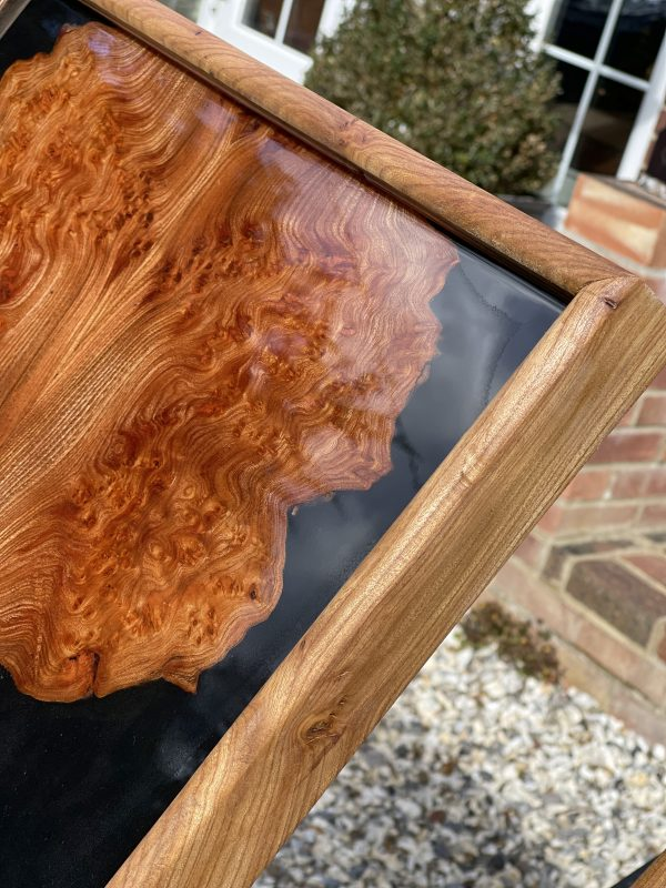 Close up of black resin and elm wall art